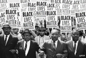 MLK and others marching with Black Lives Matter signs